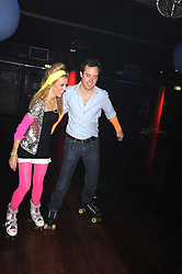 EVY LANGTON and JAMIE MURRAY-WELLS a at a Roller Disco in aid of Tom's Ward at the Children's Hospital in Oxford and the charity Place2Be, held at The Renaissance Rooms, London SW8 on the 17th September 2008.<br /> EVY LANGTON and JAMIE MURRAY-WELLS a at a Roller Disco in aid of TomÕs Ward at the ChildrenÕs Hospital in Oxford and the charity Place2Be, held at The Renaissance Rooms, London SW8 on the 17th September 2008.