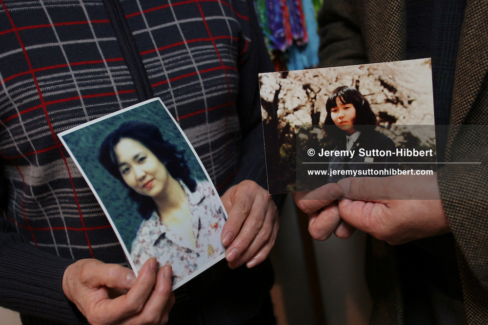 Shigeru Yokota, on right, and wife Sakie, hoild pictures of daughter Megumi Yokota, abducted in 1977 at the age of 13, from Japan, by North Korea spies. The photograph on the left shows a woman believed to be Megumi Yokota in North Korea as an adult.