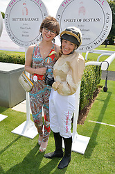 Left to right, JESSICA SALMON and her mother CLARE SALMON at the 2014 Glorious Goodwood Racing Festival at Goodwood racecourse, West Sussex on 31st July 2014.