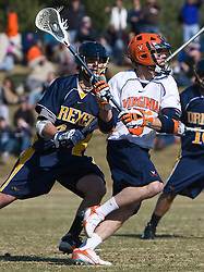Virginia Cavaliers M/A Steve Giannone (5) prepares a shot against Drexel.  The #2 ranked Virginia Cavaliers defeated the Drexel Dragons 13-7 at the University of Virginia's Klockner Stadium in Charlottesville, VA on February 14, 2009.