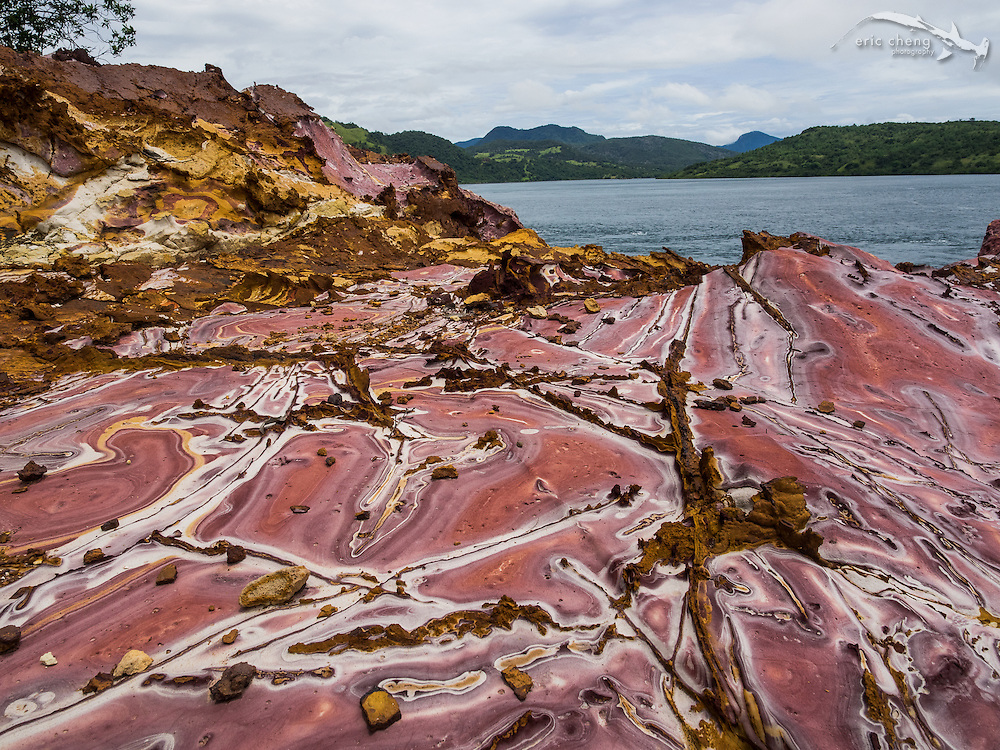 """An unusual rock formation on the south-east corner of Pulau Nisapurung, Indonesia, which we called """"Strawberry Rock."""" Some parts of the rock contained large amounts of oxidized iron."""