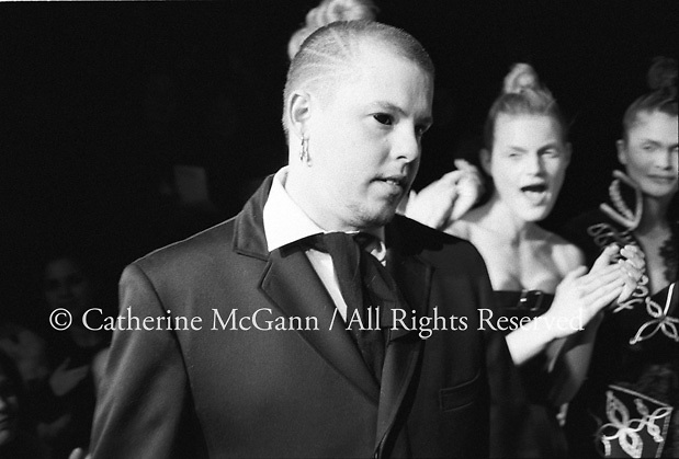 March 1996:  Alexander McQueen's first fashion show in New York.  The collection was shown in a former synagogue on Norfolk Street (now the Angel Orensanz Foundation Center for the Arts) on the Lower East side in New York City, New York.  Here McQueen walks the runway at the end of the show...
