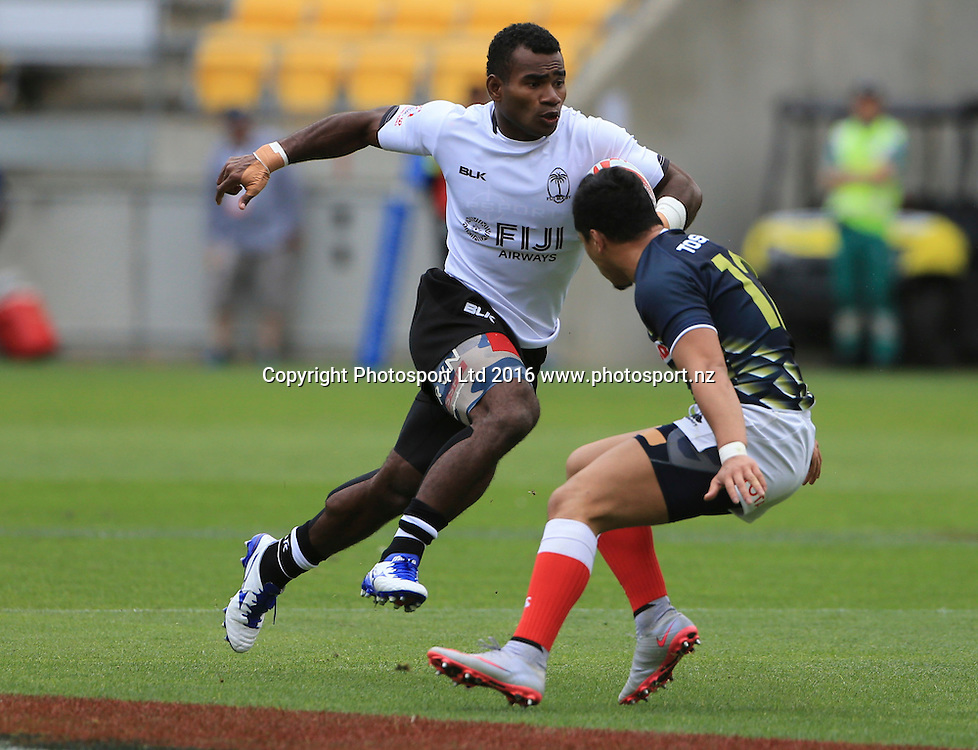 Fiji's Jerry Tuwai makes a break against Japan, Day1, HSBC World Sevens Series, Westpac Stadium, Wellington, New Zealand. Saturday, 30 January, 2016. Copyright photo: John Cowpland / www.photosport.nz