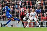 Kasper Schmeichel (1) Goalkeeper of Leicester City makes a save from Junior Stanislas (19) of AFC Bournemouth during the Premier League match between Bournemouth and Leicester City at the Vitality Stadium, Bournemouth, England on 30 September 2017. Photo by Graham Hunt.