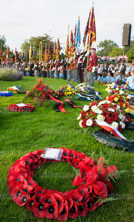 20140919       Copyright image 2014&copy;<br />  ,Daily Telegraph,  Daily Telegraph,<br /> Poppy Wreaths and Parachute Regiment Standard Bearers at the 'Bear Pit' during a wreath laying ceromany for the 70th Anniversay of the Battle of Arnhem<br /> <br /> The Bear Pit, Arnhem Town Centre memorial event<br /> <br /> For photographic enquiries please call Anthony Upton 07973 830 517 or email info@anthonyupton.com <br /> This image is copyright Anthony Upton 2014&copy;.<br /> This image has been supplied by Anthony Upton and must be credited Anthony Upton. The author is asserting his full Moral rights in relation to the publication of this image. All rights reserved. Rights for onward transmission of any image or file is not granted or implied. Changing or deleting Copyright information is illegal as specified in the Copyright, Design and Patents Act 1988. If you are in any way unsure of your right to publish this image please contact Anthony Upton on +44(0)7973 830 517 or email: