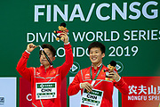 Luxian Wu of China and Zongyuan Wang of China show off their Gold Medals in the Men's Syncronised 3m dive during the FINA/CNSG Diving World Series 2019 at London Aquatics Centre, London, United Kingdom on 17 May 2019.