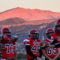 102414  Adron Gardner/Independent<br /> <br /> Sunset light strikes Mount Taylor as the Grants Pirates practice before taking on the Albuquerque Academy Chargers for homecoming in Grants Friday.