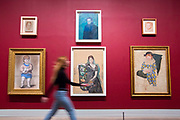 UNITED KINGDOM, London: 06 March 2018 A visitor walks past a collection of Picasso portraits at The Tate Modern's new exhibition 'Picasso 1932: Love, Fame, Tragedy'. The exhibition, which consists of a wide range of Picasso works, runs from 8th March - 9 September 2018.  Rick Findler / Story Picture Agency