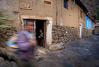 OLLANTAYTAMBO, PERU - CIRCA OCTOBER 2015:  People in the streets of Ollantaytambo, a small village in the Cusco region known as Sacred Valley