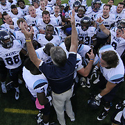 University of Maine head coach Jack Cosgrove (Center) and his players celebrate a Week 6 victory over 15th rank Delaware Saturday. Oct 6. 2012, at Delaware stadium in Newark Delaware.