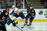 KELOWNA, CANADA - DECEMBER 1: Kirby Dach #77 of the Saskatoon Blades skates ahead of Nolan Foote #29 of the Kelowna Rockets  on December 1, 2018 at Prospera Place in Kelowna, British Columbia, Canada.  (Photo by Marissa Baecker/Shoot the Breeze)