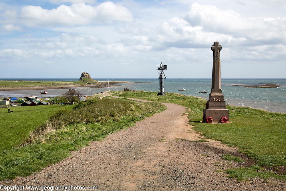 War memorial and castle, Holy Island, Lindisfarne, Northumberland, England, UK