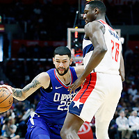 09 December 2017: LA Clippers guard Austin Rivers (25) drives past Washington Wizards center Ian Mahinmi (28) during the LA Clippers 113-112 victory over the Washington Wizards, at the Staples Center, Los Angeles, California, USA.