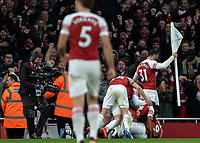 Football - 2018 / 2019 Premier League - Arsenal vs. Tottenham Hotspur<br /> <br /> Sead Kolasinac (Arsenal FC) picks out he corner flag as his team mates celebrate with Alexandre Lacazette (Arsenal FC) at The Emirates.<br /> <br /> COLORSPORT/DANIEL BEARHAM