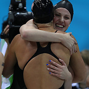 Missy Franklin, USA, right) congratulates team mate Allison Schmitt after the Women's 4 x 200m Freestyle Relay Final won by the USA at the Aquatic Centre at Olympic Park, Stratford during the London 2012 Olympic games. London, UK. 1st August 2012. Photo Tim Clayton