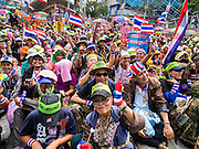 16 FEBRUARY 2014 - BANGKOK, THAILAND:  People cheer for anti-government speakers at the Pathum Wan stage of the anti-government Shutdown Bangkok protests. Pathum Wan is the stage next to MBK shopping center. The protests, organized by the  People's Democratic Reform Committee (PDRC), have tried to shutdown the Thai capital but crowds at the venues are getting smaller and police have taken back a couple of protest sites.    PHOTO BY JACK KURTZ