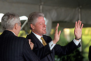 US President Bill Clinton is applauded during a ceremony on the South Lawn of the White House September 11, 1998 in Washington, DC. Clinton received the Paul O'Dwyer Peace and Justice Award, for Clinton's work in helping bring peace in Northern Ireland. The ceremony took place the same day the Starr Report was released to Congress.