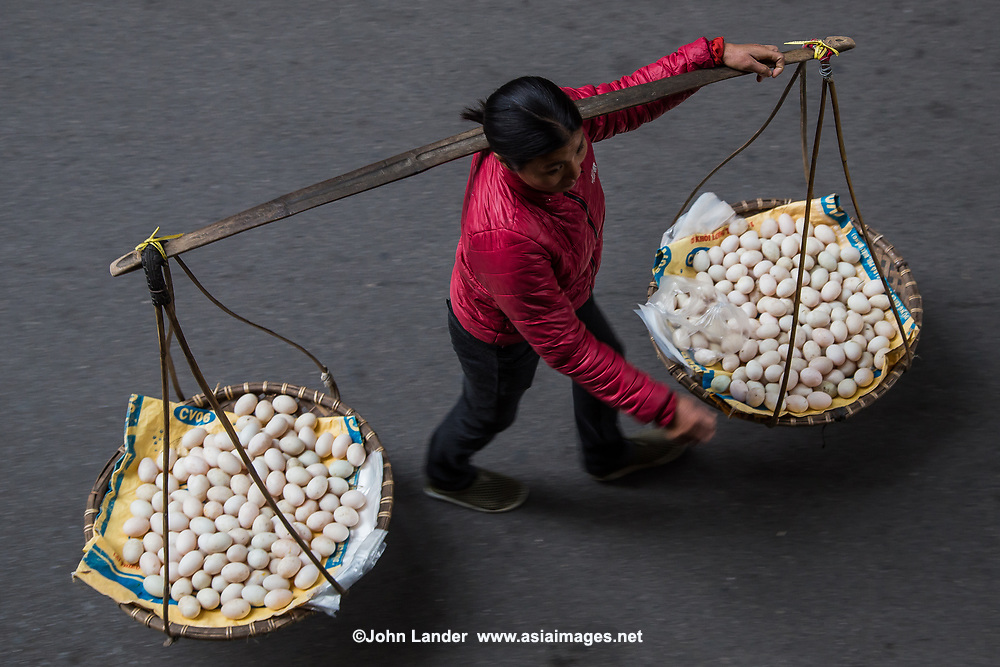 Hanoi Street Vendor Eggs - Street Vendors, Hanoi Old Quarter - In Hanoi, life is convenient for shoppers, especially housewives. . No matter where you are, you can easily get anything you need from ubiquitous street vendors. They can make their living by carrying a yoke - baskets slung from each end of a bamboo pole, or from the back of a bicycle. Street vendors are everywhere  in Hanoi. They are up before sunrise, carrying and peddling everything from baguettes to brooms to baskets.