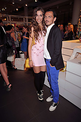 AMBER LE BON and MATTHEW WILLIAMSON at a party to celebrate the launch of the Matthew Williamson collection at H&M held at the H&M store, Regent Street, London on 22nd April 2009.