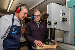 Pictured: Willie Rennie was shown the safe way to work with a band saw by Charlie Taylor, co-founder and co-leader of the Men of Leith Mens Shed<br />