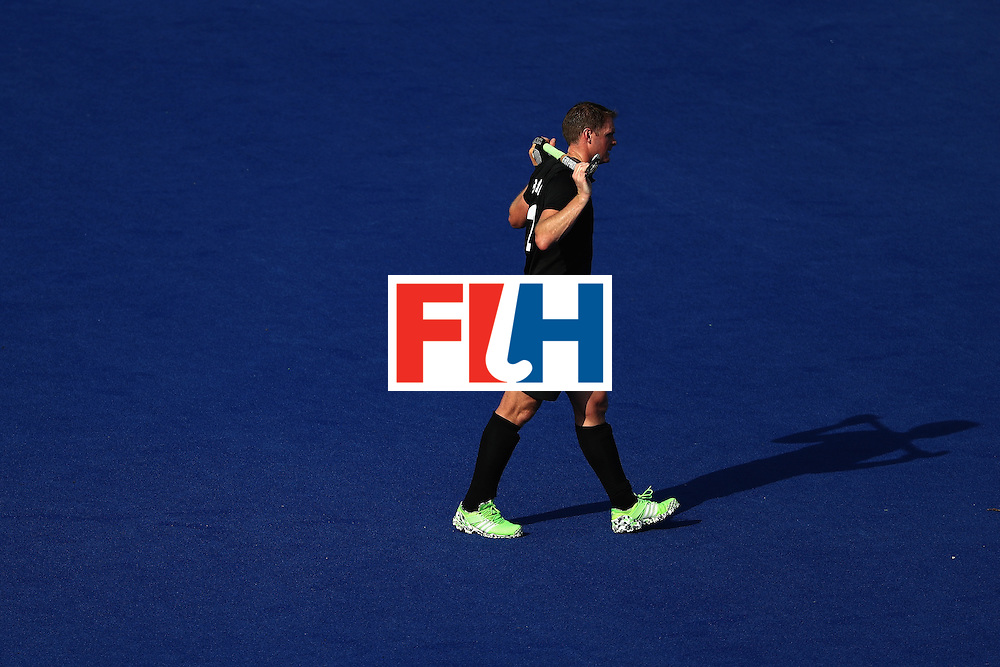 RIO DE JANEIRO, BRAZIL - AUGUST 06:  Bradley Shaw #12 of New Zealand walks off the field after a Pool A match between New Zealand and Austraiia  on Day 1 of the Rio 2016 Olympic Games at the Olympic Hockey Centre on August 6, 2016 in Rio de Janeiro, Brazil.  (Photo by Sean M. Haffey/Getty Images)