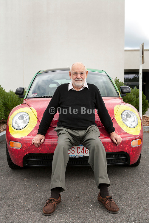 portrait of the children book illustrator and artist Eric Carle with his painted beetle car, 2006