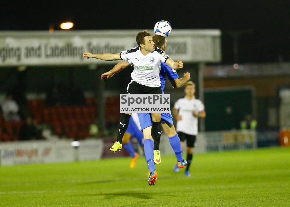 Dover's striker Ricky Miller (9) puts inn a mid air challenge. Dover Athletic v Eastleigh. Vanarama National League. 10  November 2015. (c) Matt Bristow | SportPix.org.uk