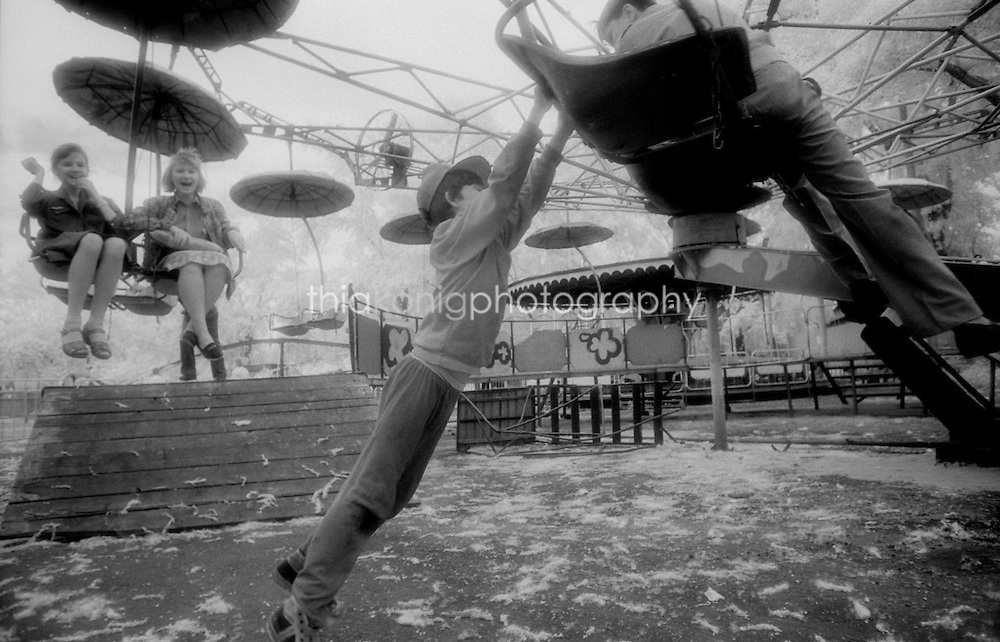 Black and white infrared image of children playing after hours at an amusement park, Krasnoyarsk, Siberia, Russia, USSR