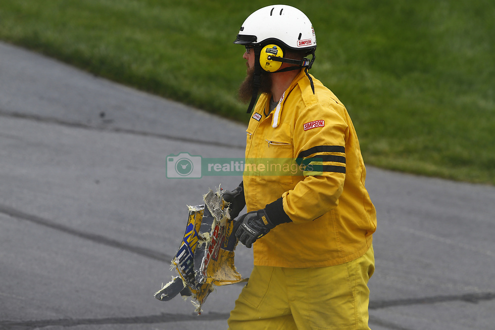 May 5, 2018 - Dover, Delaware, United States of America - A track worker collects debris after an accident during the OneMain Financial 200 at Dover International Speedway in Dover, Delaware. (Credit Image: © Chris Owens Asp Inc/ASP via ZUMA Wire)