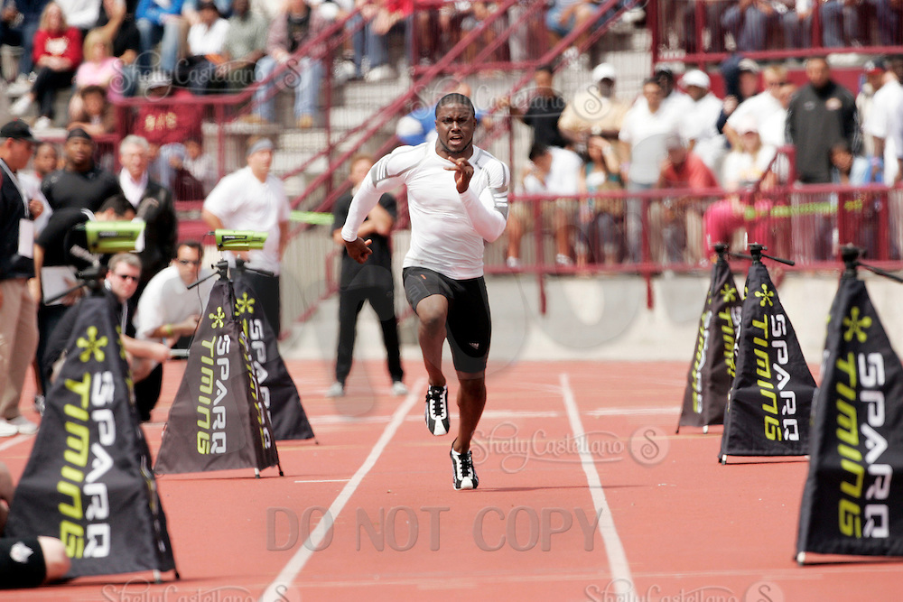2 April 2006:  OH Reggie Bush sprints at the 40 yard dash at pro-day timing workout by pro football teams at NFL pro-timing day at USC college campus in Los Angeles, CA.  Bush finished with a 4.33 time.