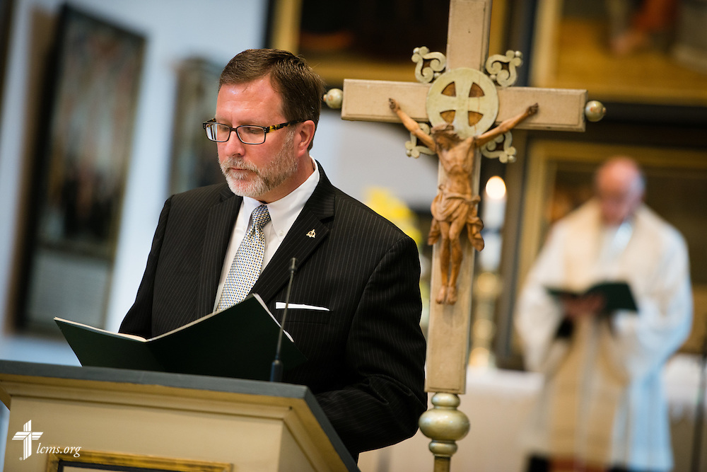Dr. Bruce Kintz, president and CEO of Concordia Publishing House, reads during the Festival Dedication Service at the Town and Parish Church of St. Mary's before the dedication of The International Lutheran Center at the Old Latin School on Sunday, May 3, 2015, in Wittenberg, Germany. LCMS Communications/Erik M. Lunsford