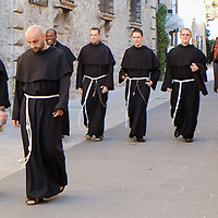 ASSISI, ITALY - OCTOBER 03:  A groups of franciscans friars walk in Assisi ahead of the visit of Pope Francis on October 3, 2013 in Assisi, Italy. Pope Francis is due to venerate the tomb of San Francesco of Assisi tomorrow during his one-day visit to the city.  (Photo by Marco Secchi/Getty Images)