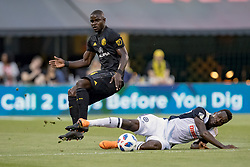 May 9, 2018 - Columbus, OH, U.S. - COLUMBUS, OH - MAY 09: Philadelphia Union forward C.J. Sapong (17) slides in to take the ball from Columbus Crew defender Jonathan Mensah (4) in the MLS regular season game between the Columbus Crew SC and the Philadelphia Union on May 09, 2018 at Mapfre Stadium in Columbus, OH. (Photo by Adam Lacy/Icon Sportswire) (Credit Image: © Adam Lacy/Icon SMI via ZUMA Press)