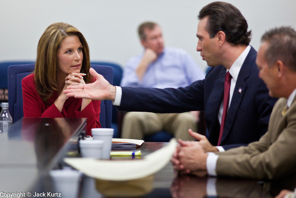 17 OCTOBER 2011 - PHOENIX, AZ:  MICHELE BACHMANN, Republican candidate for President of the US, talks to Arizona State Sen. Steve Smith at the Arizona capitol in Phoenix. Bachmann met with Republican Arizona legislators and Republican members of the state's Congressional delegation Monday morning to talk about illegal immigration and border security. During the meeting she pledged that if she were elected US President, she would construct a fence along the US - Mexico border.    PHOTO BY JACK KURTZ