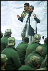Imam Asim Hafiz  praying with Afghan Army Troops on a visit to  Camp Qargha in Kabul, 19th January 2014 . Picture by Andrew Parsons / Parsons Media Ltd