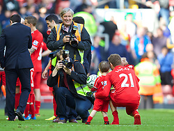 LIVERPOOL, ENGLAND - Sunday, May 11, 2014: Andrew and John Powell, Getty club photographers, tale photos of Lucas Leiva after the Premiership match at Anfield. (Pic by David Rawcliffe/Propaganda)