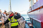 Coordinating the supplies loading onto the Boa Sub C Multi purpose Offshore Vessel