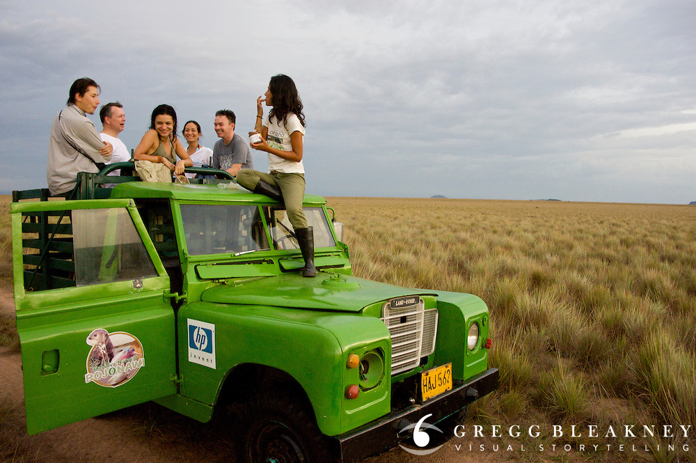 A group of conservationalist enjoy a chocolate break while on Safari in la Reserva Natural Bojonawi - Orinoco River Basin - Colombia - South America