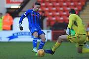 Ian Henderson is thwarted by Liam Roberts during the EFL Sky Bet League 1 match between Walsall and Rochdale at the Banks's Stadium, Walsall, England on 2 February 2019.