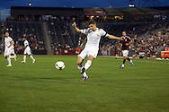 July 24th, 2012:  Swansea City AFC midfielder Ben Davies (33) takes a shot on goal as Colorado Rapids host Swansea City AFC for a international friendly soccer match in Denver, CO.  The Rapids would go on to win 2-1.