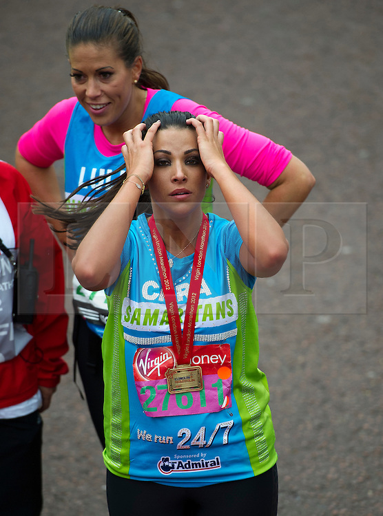 © London News Pictures. 22/04/2012. London, UK. Cara Kilbey from The Only Way IS Essex at the finnish line at the 2012 Virgin London Marathon in London on April 22, 2012. Photo credit : Ben Cawthra /LNP