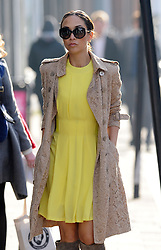 Myleene Klass wearing large sunglasses, a £1,395.00 Burberry beige lace trench coat, yellow dress and a pair of suede knee high boots, out and about in north London, UK. 12/03/2015<br />