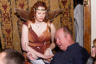 "Tamra Francis (standing) helps an audience member read his lines during Mayhem & Mystery's production of ""Tragedy in the Theater"" at the Spaghetti Warehouse in downtown Dayton, Monday, February 28, 2011.  Help from the audience is one reason they bill it as interactive entertainment."