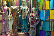 Sari clothes shop in city of Varanasi, Benares, Northern India
