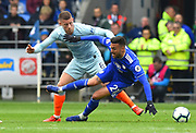 Ross Barkley (8) of Chelsea battles for possession with Victor Camarasa (21) of Cardiff City during the Premier League match between Cardiff City and Chelsea at the Cardiff City Stadium, Cardiff, Wales on 31 March 2019.