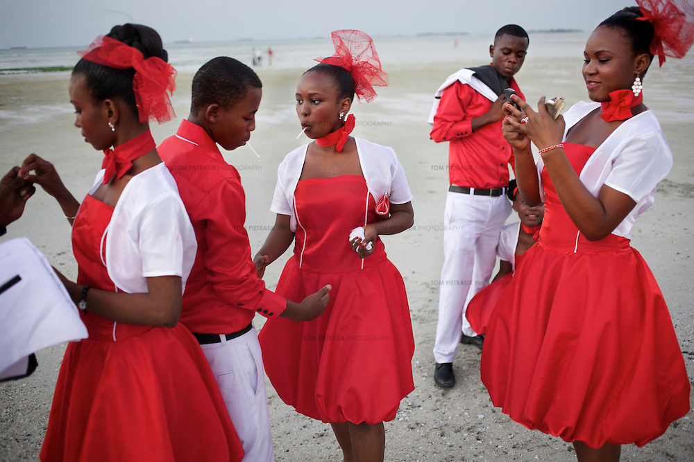 A wedding party gather for photographs on the beach in Dar es Salaam...Photo: Tom Pietrasik.Dar es Salaam, Tanzania.June 25th 2011