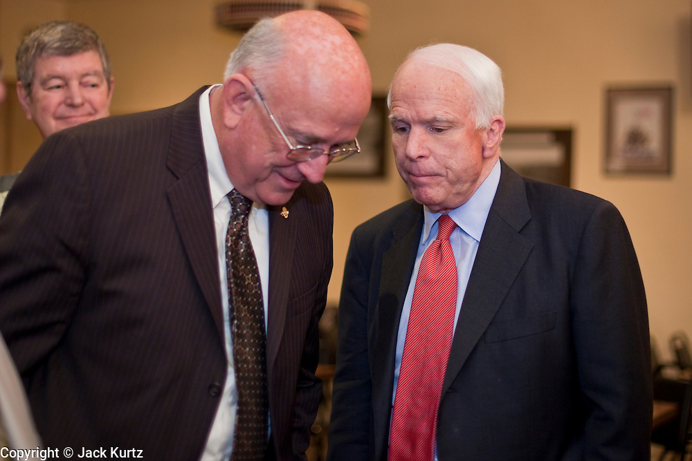 15 FEBRUARY 2010 -- TEMPE, AZ: Bob Walkup (LEFT), Mayor of Tucson, AZ, talks to Sen John McCain before McCain's press conference at American Legion Hall Post 2 in Tempe Monday morning. McCain introduced more than 30 mayors from across Arizona that have or will be endorsing him in his primary against former TV sports anchor and Congressman J.D. Hayworth. Hayworth, an arch conservative, is running against McCain for being too liberal on spending and immigration.    PHOTO BY JACK KURTZ