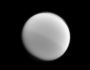 Light and dark halves of Titan are visible in this Cassini image which illustrates the seasonal changes in the northern and southern hemispheres.