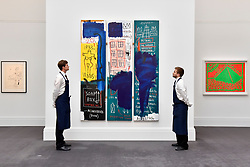 "© Licensed to London News Pictures. 23/06/2017. London, UK. Technicians view ""Untitled"", 1983, by Jean-Michel Basquiat (estimate GBP4-6m) at the preview of Sotheby's Contemporary Art Sale in New Bond Street.  The auction, which is dominated by Pop art, takes place on 28 June. Photo credit : Stephen Chung/LNP"
