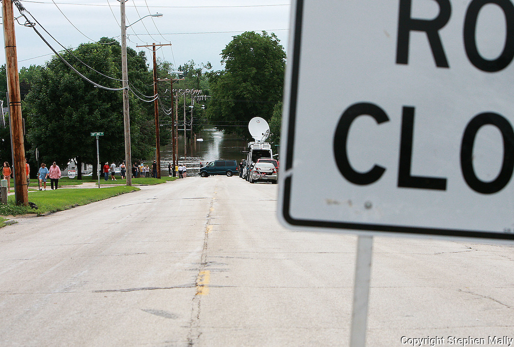 Massive flooding has covered the Midwest section of the United States. In Cedar Rapids, Iowa over 400 blocks were underwater. Other towns are now bracing for the water as it continues downstream.///A road closed sign blocks a flooded street in Cedar Rapids, Iowa.
